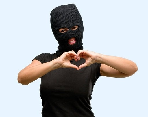 bigstock-Burglar-terrorist-woman-wearin-238478110-794217-edited